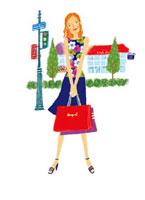 ショッピングバッグを持って立つ女性