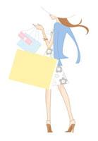 ショッピングバッグを持って立つ女性の後姿