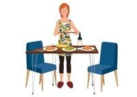 パスタやサラダを並べる女性