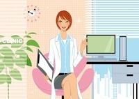 パソコンの前に座る女医