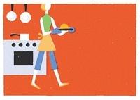 オーブンから料理を運ぶ女性