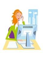 インカムをつけてパソコン操作をする女性