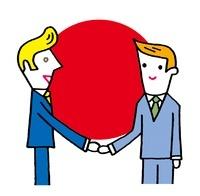 外国人と握手をする日本人ビジネスマン