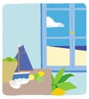 窓辺の船や貝殻の置かれたデスクと観葉植物