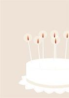 ろうそくを灯したケーキ