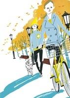 自転車に乗る女性とイヌを連れた男性