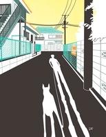 犬の散歩をする人の影と路地
