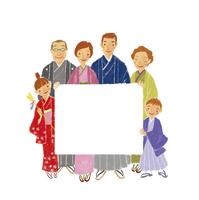 メッセージボードを持つ着物を着た三世代家族