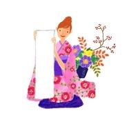 書き初めの用紙を持つ着物を着た女性