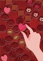 たくさんのチョコの中からハートのチョコをつまむ手