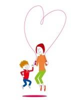 縄跳びをする男の子と母親