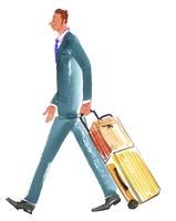 スーツを着てスーツケースをひく男性