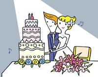 ウエディングケーキにナイフをいれるカップル