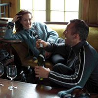 Relaxed couple drinking wine