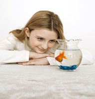 Little girl with a goldfish