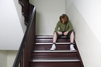 Boy on stairs listening to music