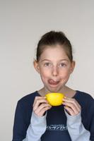 School age child with lemon
