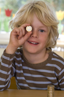 Toddler with a coin