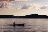 Man canoeing on lake Ontario