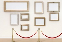 Empty picture frames behind cordon in art gallery