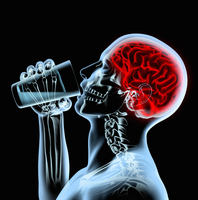 X-ray of man with red brain drinking from glass