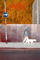 Man walking dog in run down city
