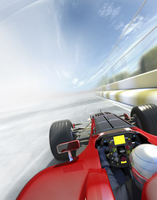 Racing car and driver speeding on race track