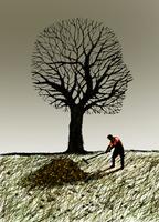 Man raking autumn leaves under anthropomorphic tree