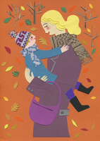 Autumn leaves falling around mother hugging son face to face