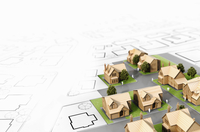 Housing development models on blueprint plan