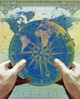 Hands holding navigation compass over chart of world map