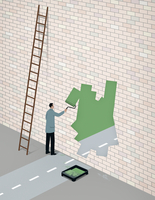 Businessman painting road opening through brick wall