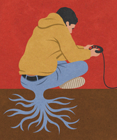 Teenage boy playing with games console and rooted to the ground