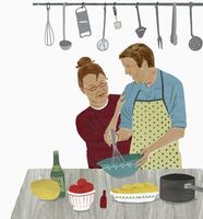 Older couple enjoying cooking together