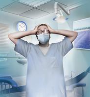 Stressed dentist in despair
