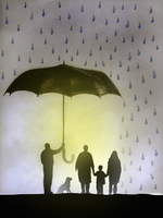 Businessman holding umbrella protecting family