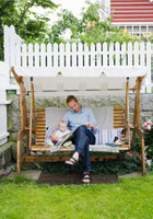 Father and baby in garden hammock