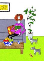 ソファで本を読む女の子と2匹の犬