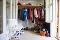 Dressing room - clothes rail with shelf and a white wooden b
