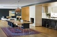 A dining room in an open-plan living room-cum-dining room wi