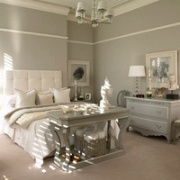 A grey-painted bedroom in a period building - a grey table a