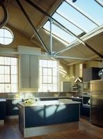 Central island unit in kitchen with industrial style pitch r