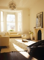 Light, sitting room with neutral furnishings and large windo
