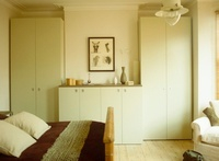 Pair of wardrobes set in recesses in bedroom