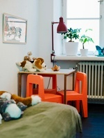 A table and small chairs in a child's room