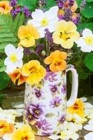 Lavender and nasturtiums in a vase