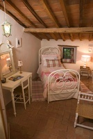 White, antique iron bed with a dressing table and mirror und