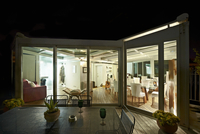 Night-time view from terrace with garden table into illumina