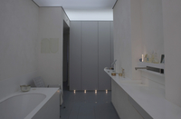 Half-darkened bathroom in designer style -- vanity top with
