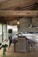 Renovated country home - dining area under a rustic wooden b